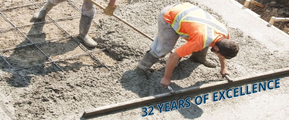 32 Years of Excellence | Crew Finishing Concrete